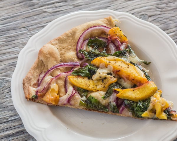 Peach and Arugula Pizza slice