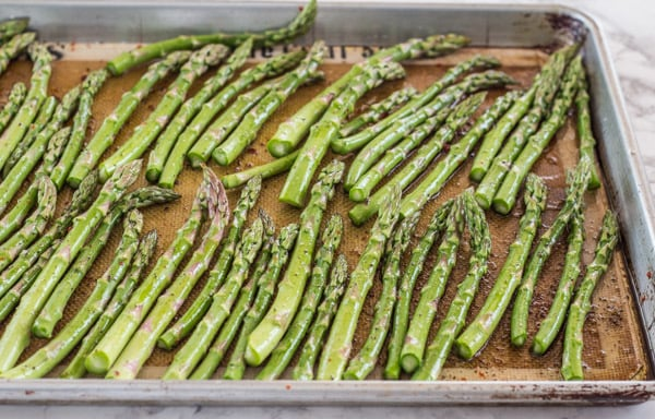 asparagus ready for the oven--for Roasted Asparagus and Sweet Potato Noodles with Goat Cheese Sauce