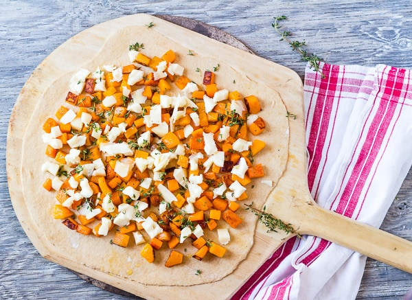 Ready for the oven, Butternut Squash and Taleggio Pizza from Vegetables: Inspired Recipes and Tips—a Martha Stewart cookbook.