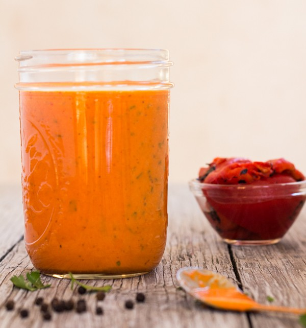 Roasted Red Pepper Vinaigrette in jar direct photo with bowl of red peppers