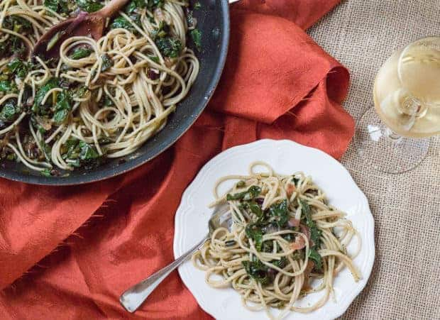 Spaghetti with Beet Greens and Basil Pesto plate and pan