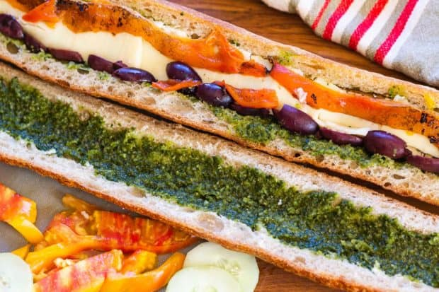 building the layers in pan bagnat with pesto