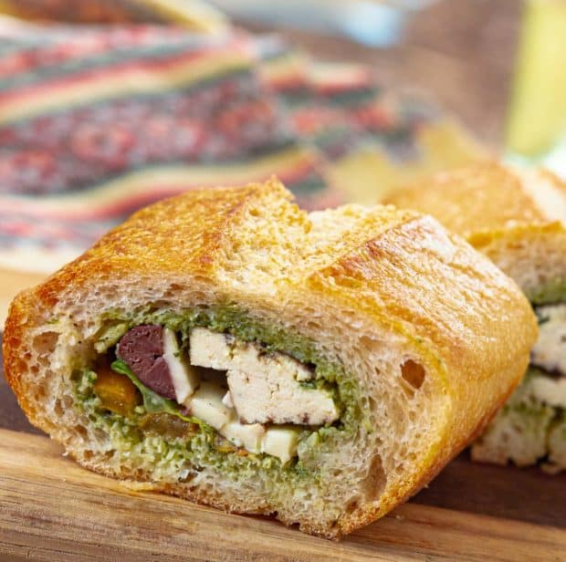 3 inch slices of filled pan bagnat with pesto