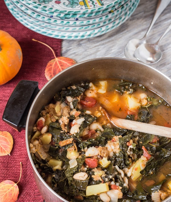 Portuguese Kale and Potato Soup in pot ready to dish out