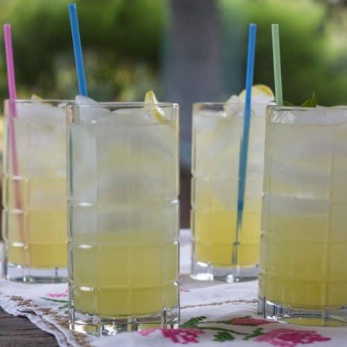 Lemon Basil Lemonade in 4 tall glasses with straws