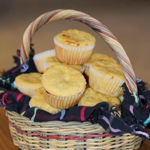 Green Chile and Cheese Corn Muffins in basket with handle
