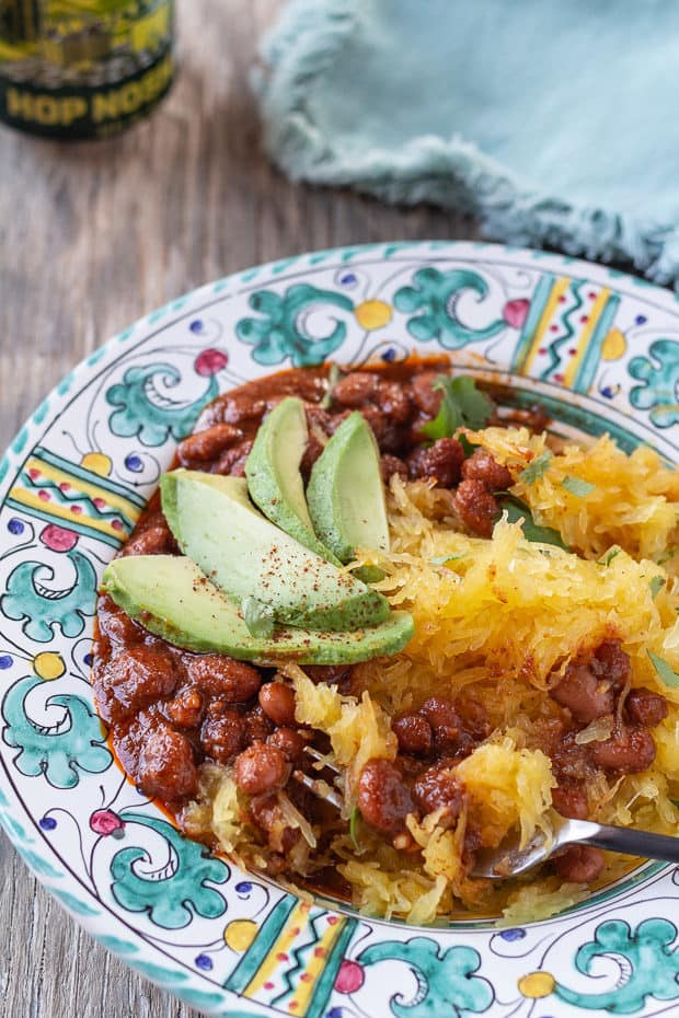 Roasted Spaghetti Squash with Pinto Beans in patterned bowl