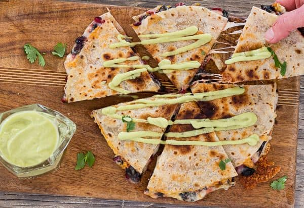 A wedge of Chard and Pepper Jack Quesadillas with Avocado Cream | Letty's KItchen