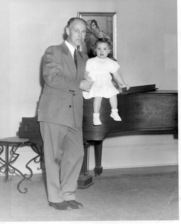 Letty on the piano next to her Father