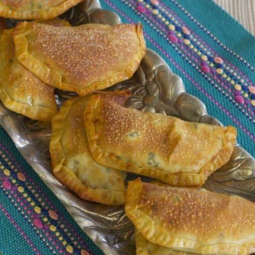 Kale and Kalamata olive turnovers on platter