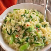bok Choy risotto done and ready to eat in white bowl