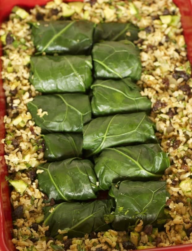 collard rollups nestled in extra rice pilaf for Collard Rolls with Rice Pilaf