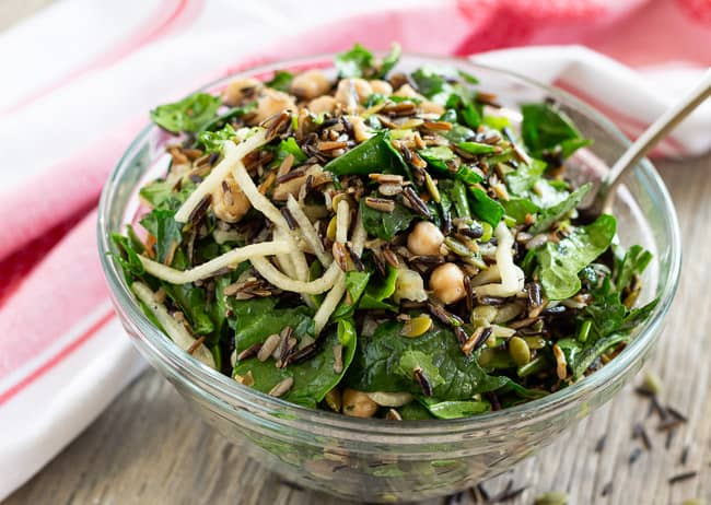 Wild Rice Arugula Salad with Chickpeas in a glass bowl ready to serve