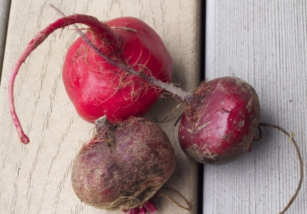 fresh beets on wooden boards