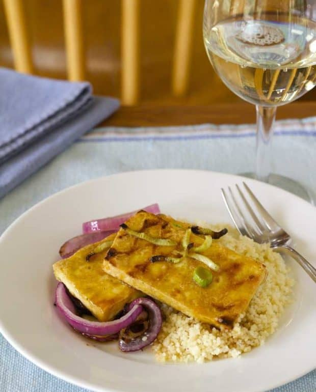 jalapeno orange glazed tofu with red onions and fennel with glass of white wine
