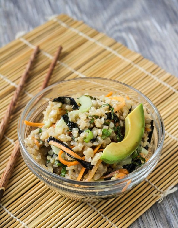 Brown Rice Sushi Salad in bowl on sushi mat with chopsticks | Letty's Kitchen