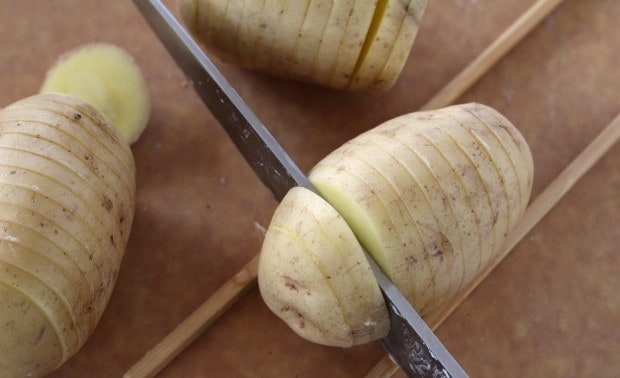 cutting potatoes for Hasselback Potatoes with Dukkah Spice