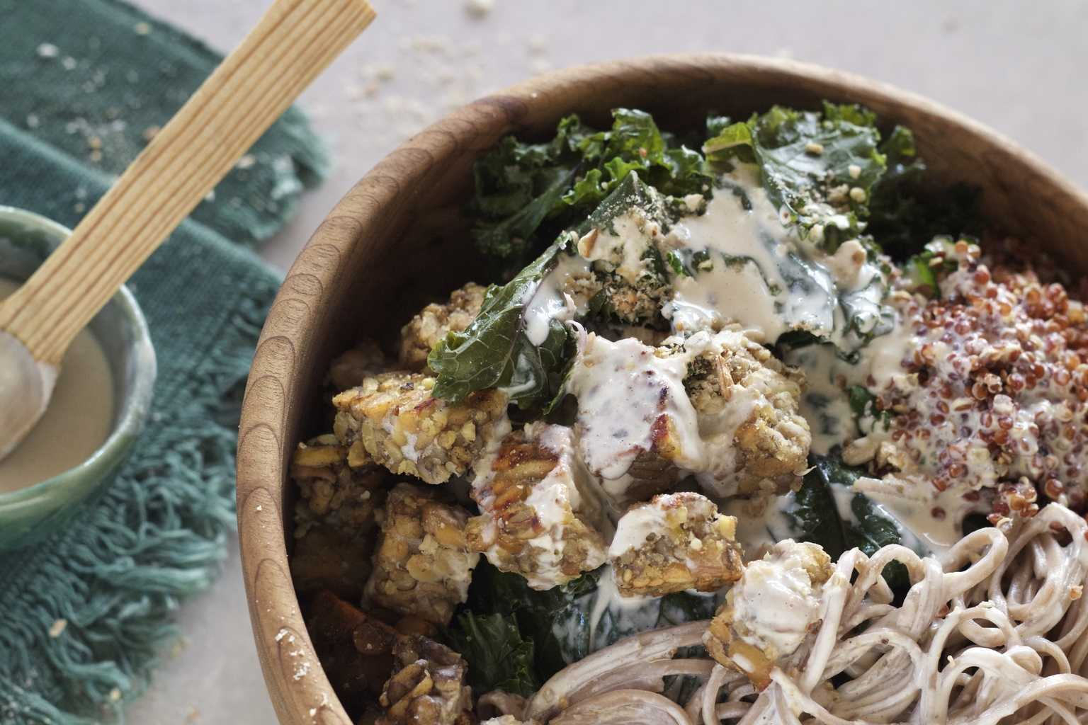 Soba Noodle and Kale Bowl with Tahini Sauce drizzled on top