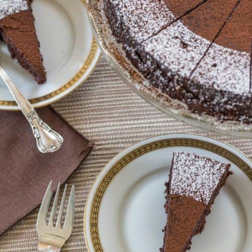 Bittersweet Chocolate Torte cut with whole