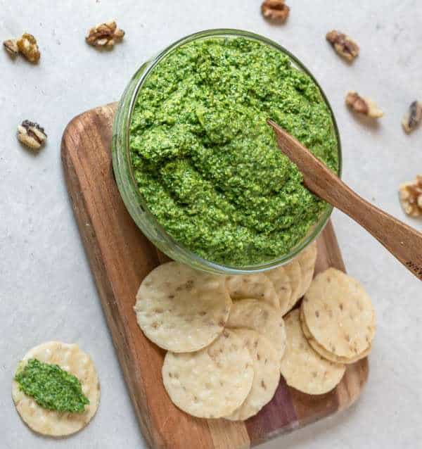 Garlic Scape and Mess O' Greens Pesto in bowl with crackers