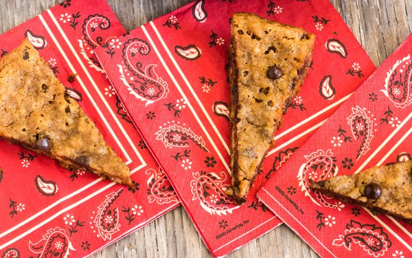 3 Skillet Chocolate Chip Walnut Cookies on red handkerchief napkins