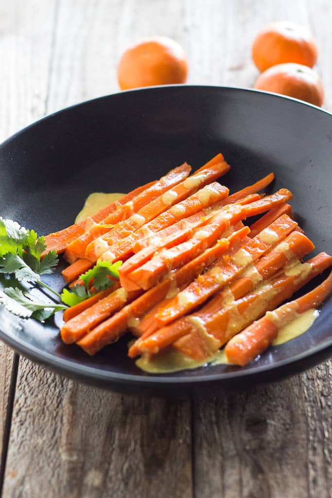 Easy carrots steamed with a bit of tequila, with creamy curry tahini sauce. Vegan and gluten free.