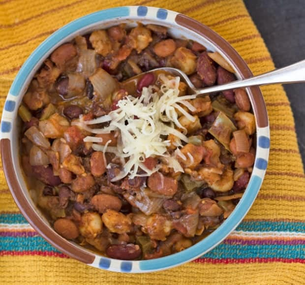 bowl of vegetarian Pantry Chili with cheese sprinkle on top.