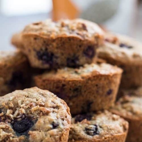 Blueberry Hemp Muffins stacked in a basket