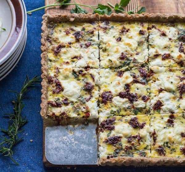 Herbed Goat Cheese and Caramelized onion Tart with one piece out