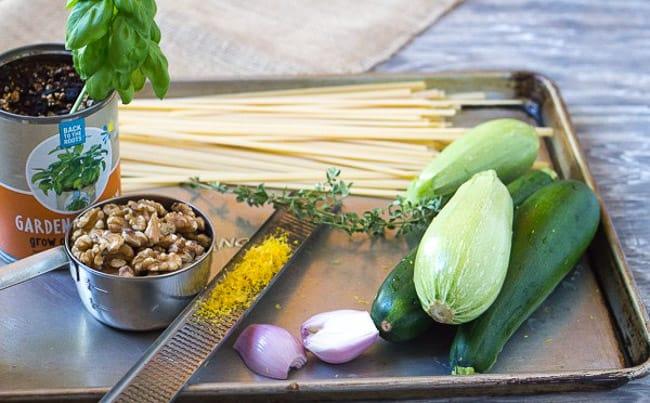 basil, walnutes, fettuccine, zucchini, shallots, lemon zest on sheet pan