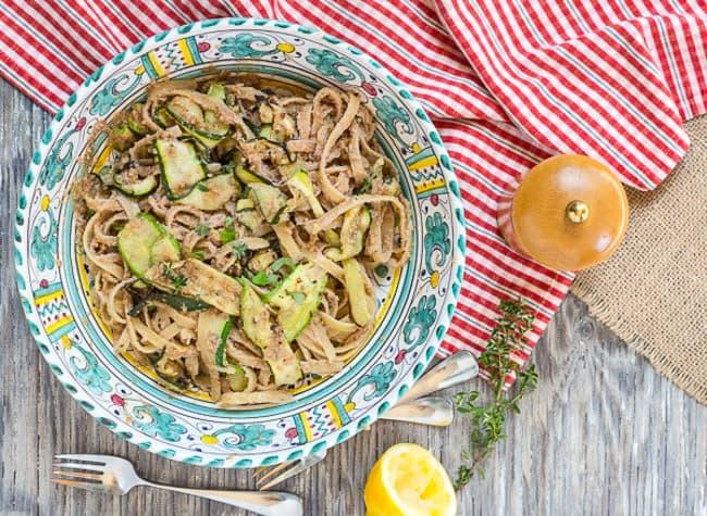 zucchini and fettuccine in Italian bowl with pesto