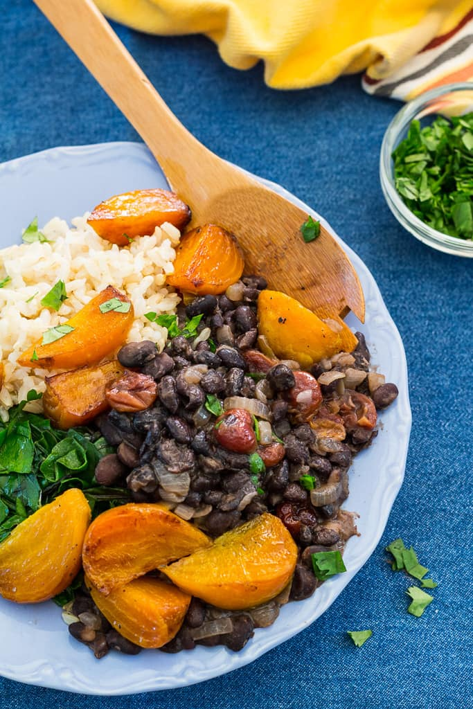 Golden beets with black beans and dried cherries, a delicious vegetarian meal inspired by Brazilian feijoada. Serve with brown rice and sautéed greens.