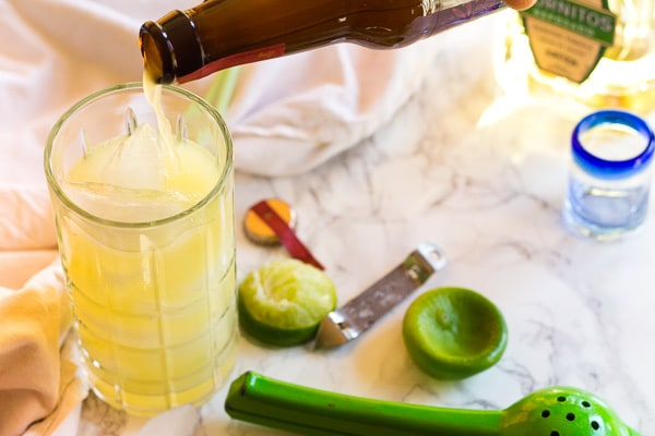 pouring ginger beer for Mexican Mule Cocktail
