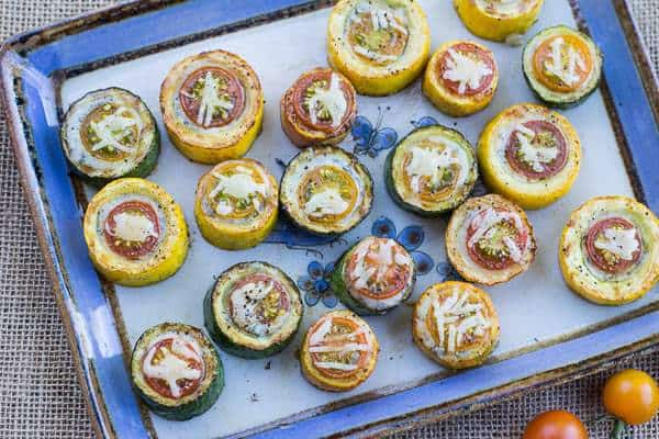Zucchini, Cherry Tomato, and Gorgonzola Bites on platter