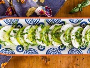 Green Zebra Tomato Caprese Salad arranged overhead shot