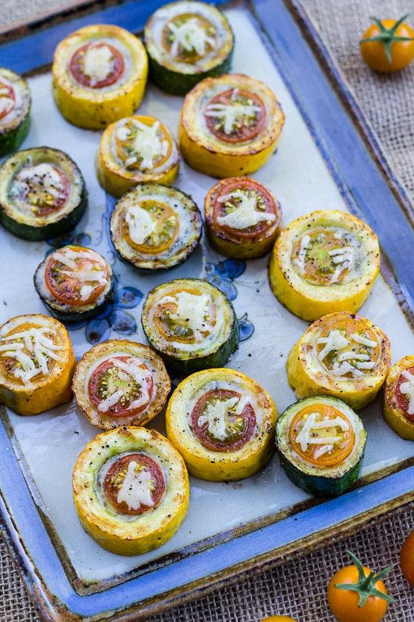 Zucchini, Cherry Tomato, and Gorgonzola Bites on a blue plattter
