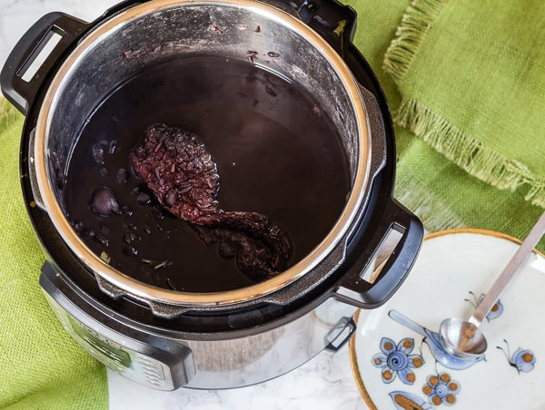 Black beans cooked in Instant Pot with whole chile seasoning for How to Cook Black Beans in a Pressure Cooker