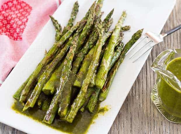 closeup horizontal shot of Roasted Asparagus with Cilantro Chimichurri Sauce