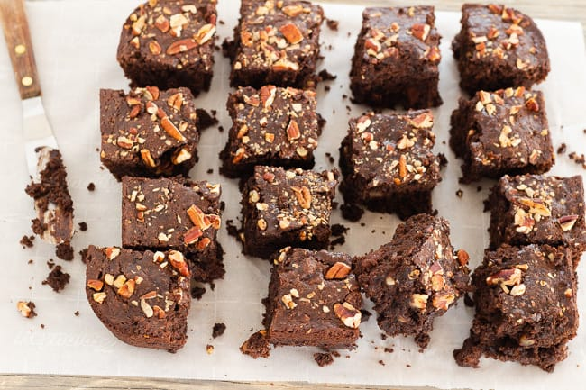 Vegan Gluten Free Chocolate Pecan Brownies cut on parchment paper