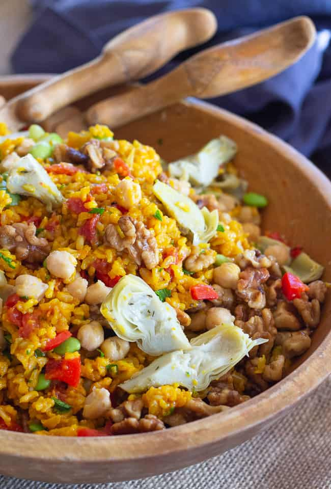 Vegetarian Paella Salad with Spiced Walnuts in wooden bowl
