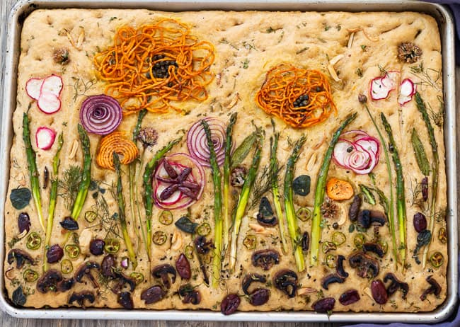 Baked fanciful Focaccia Garden of vegetables and herbs
