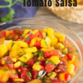 peach and tomato salsa in glass bowl with Pinterest text from Canva