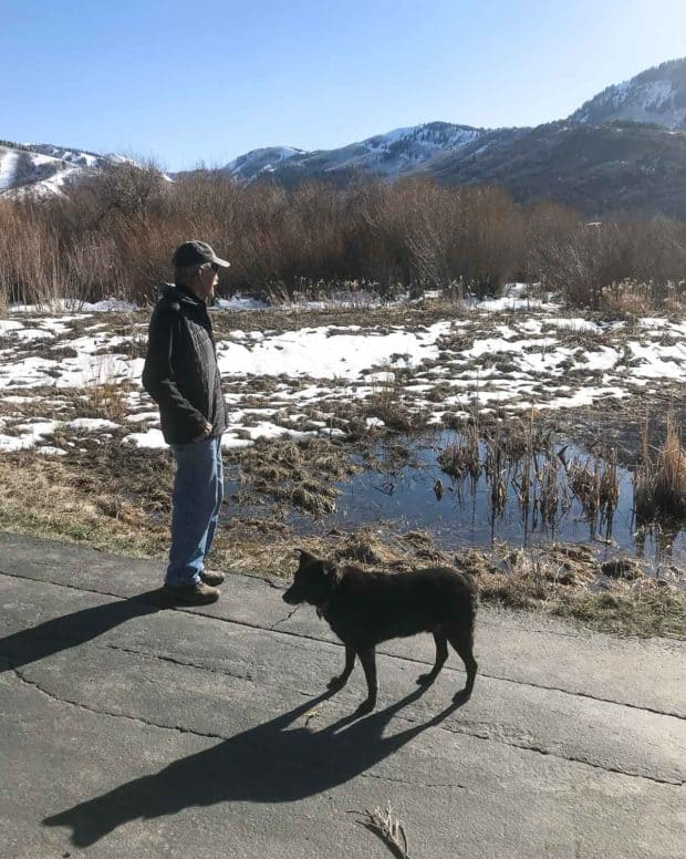 Robbie and Carlos on path with mountains andmelting snow